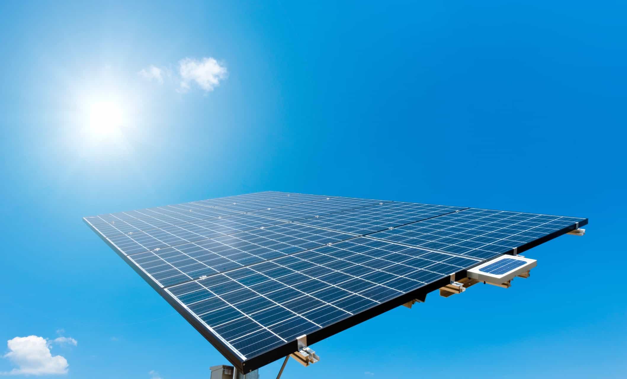 Sun shines on Solar Panel with blue Sky