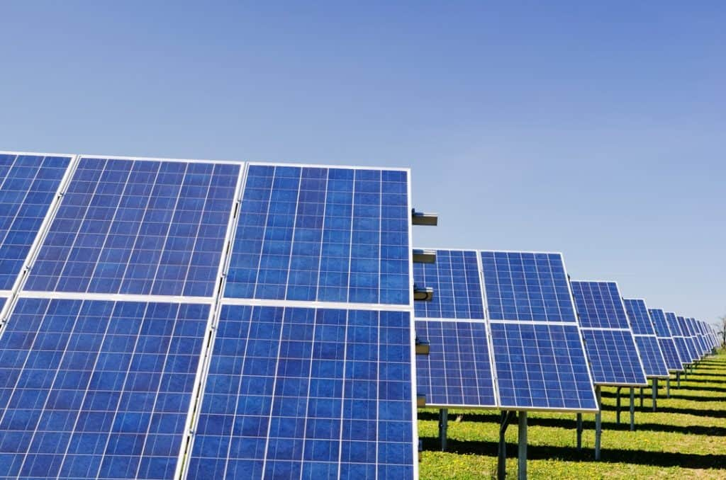 Ground Mount Solar Array In A Grass Field